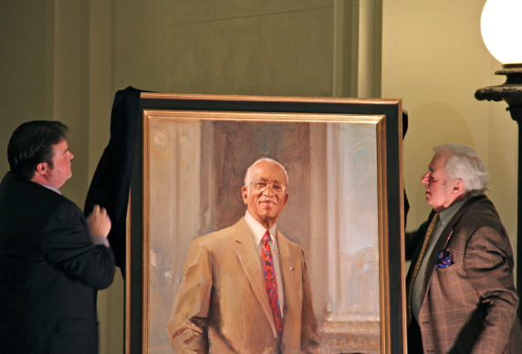 Everett Raymond Kinstler, painter, and Richard Ellwanger, Chair State Capitol Preservation Commission unveil Dr. John Hope Franklin's portrait.