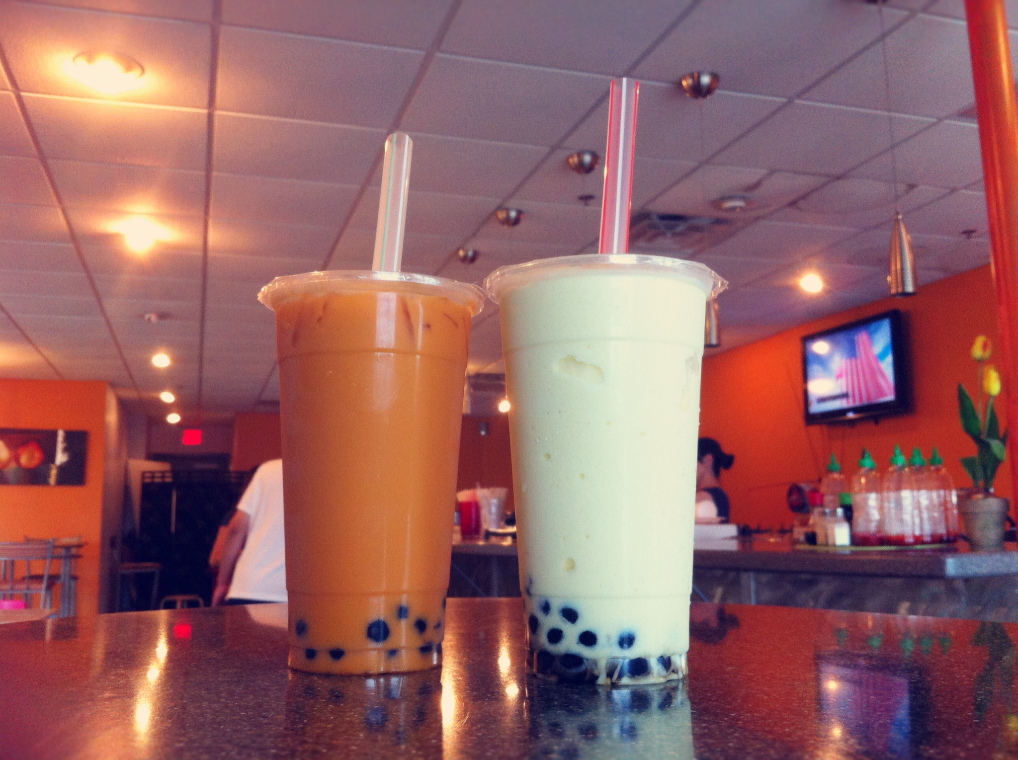 Left to Right: Thai tea and Pina Colada at Cafe Oasis.