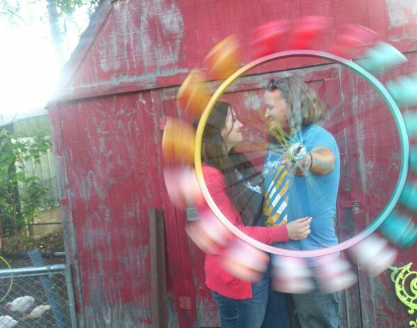 I don't think I've met as sweet and creative a couple as Brian and Stephanie. That's a bicycle wheel with spray painted two liter bottoms attached, which of course they've turned into a kinetic sculpter, that when not being used as a prop for this picture, hangs out on their porch.