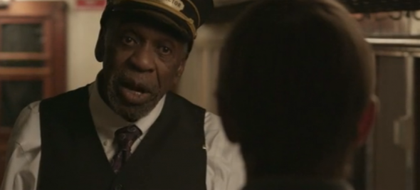 Bill Cobbs as the mysterious train conductor.