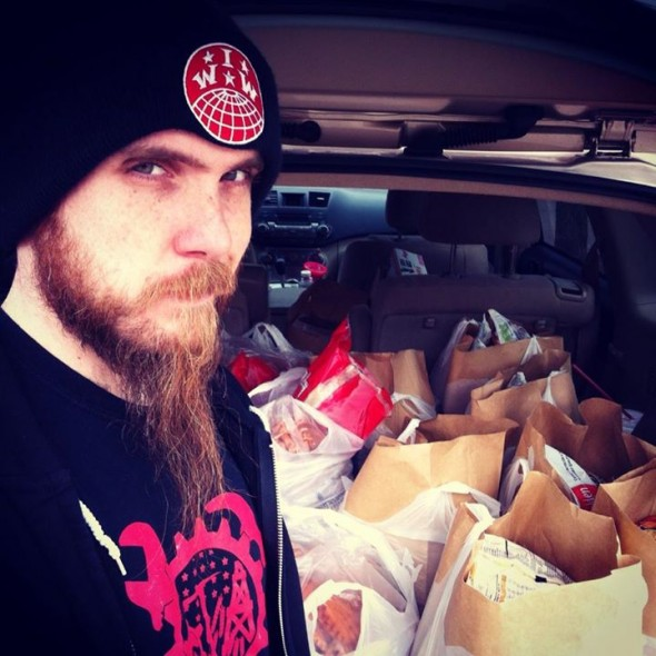 Zakk Flash delivering food to the poor in OKC with Oscar Romero Worker House.