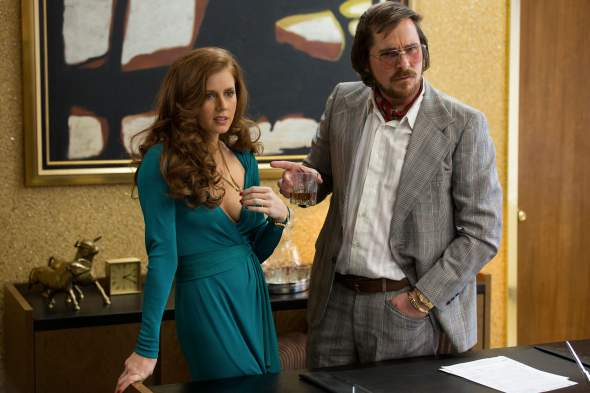 Amy Adams and Christian Bale in American Hustle - (Credit - Sony Pictures)