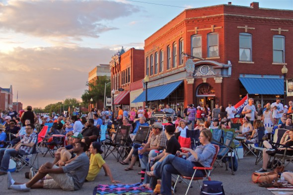 Scene of the crowd gathering at sunset at the first Make Guthrie Weird Block Party of the 2014 season.