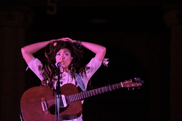 Two things: if you ever have an opportunity to see Valerie June and speak with her after a concert, as many in Guthrie did that night, you'll notice she strikes this pose a lot. Second: those roses in her hair came from a little girl in the front row.